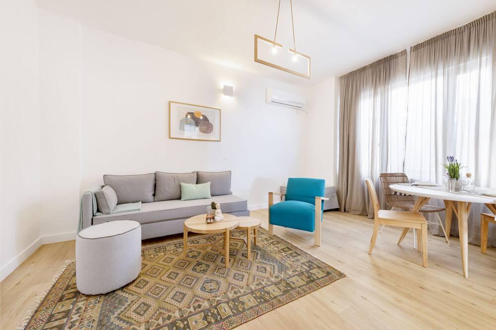 Apartmán typu Deluxe, 1 veľké dvojlôžko s rozkladacou sedačkou, nefajčiarska izba - Obývačka