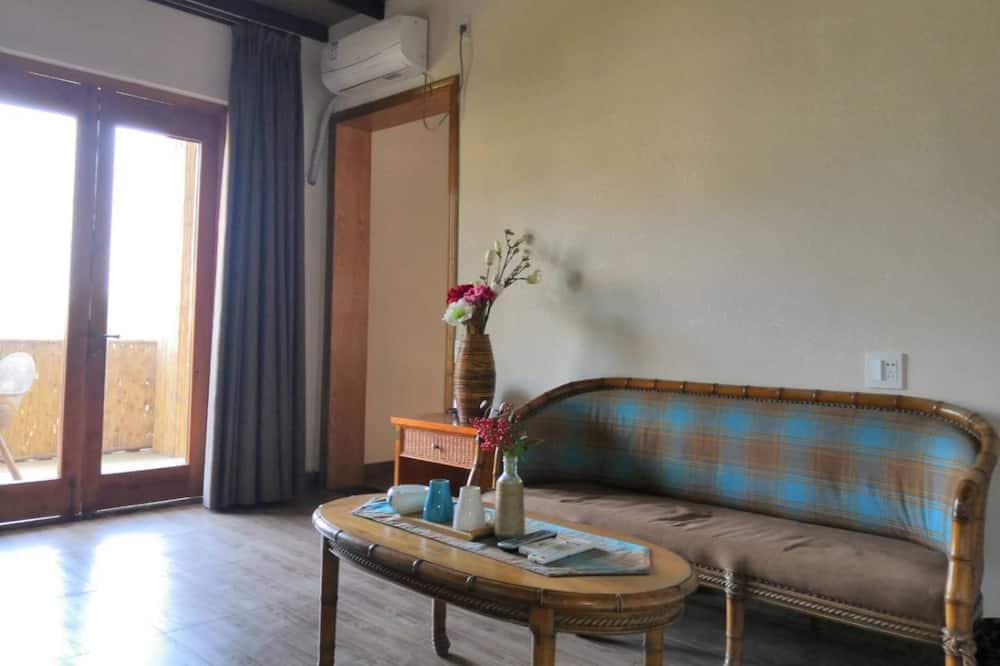 Junior-Suite, Gartenblick - Wohnzimmer