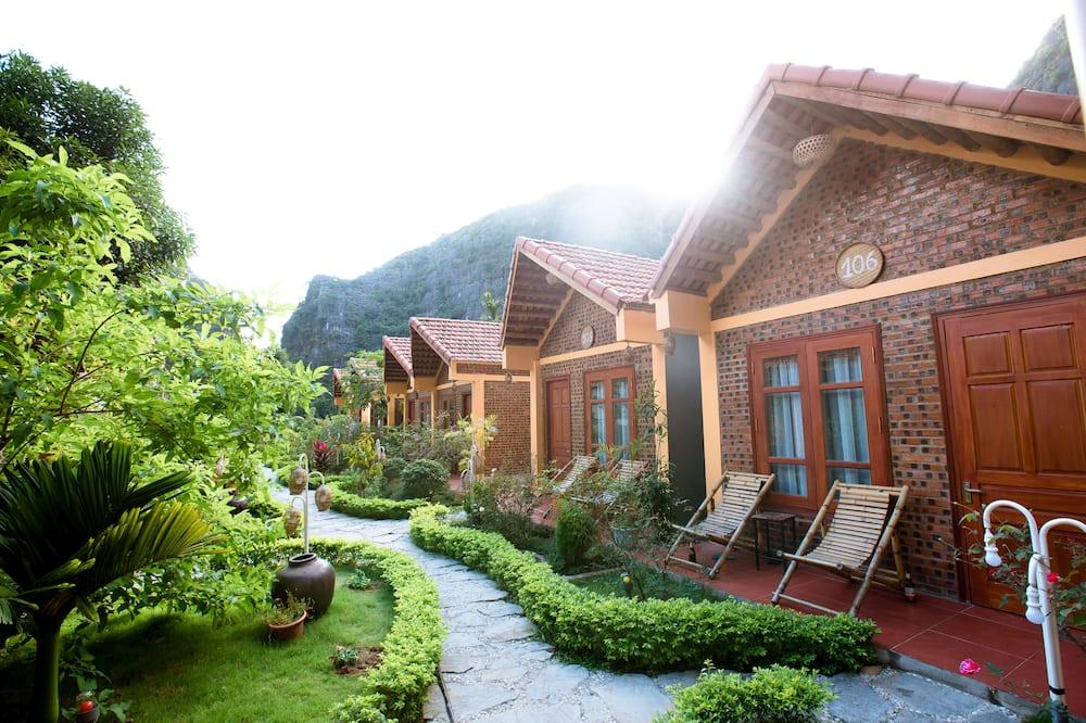 Zimmer, Gartenblick (Bungalow) - Blick auf den Garten