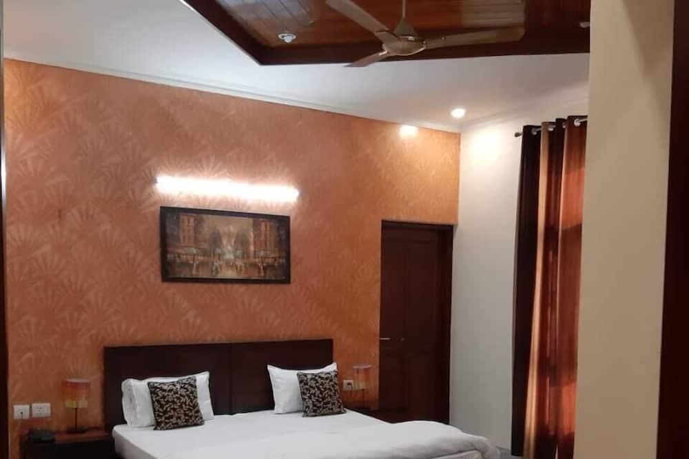 Chambre Deluxe, 1 très grand lit, fumeurs - Chambre