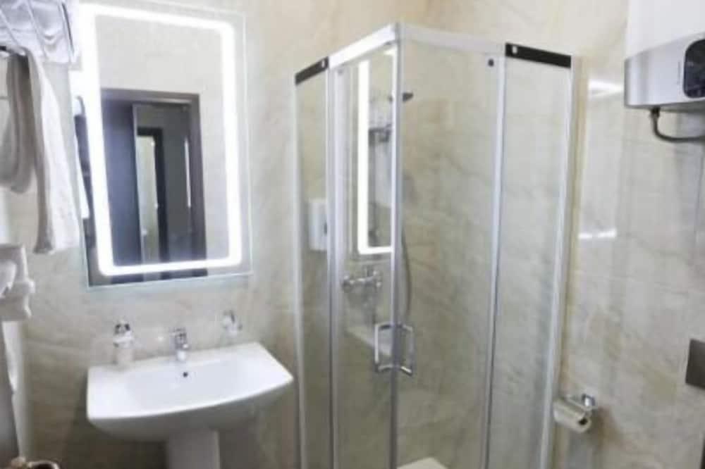 Номер «Економ» (1 двоспальне або 2 односпальні ліжка) - Ванна кімната