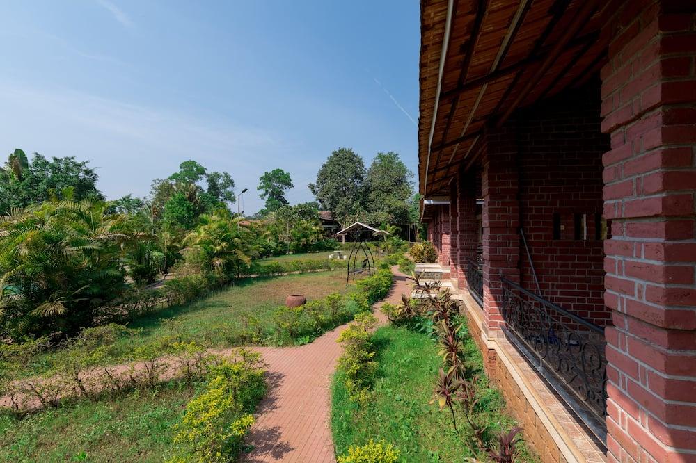 Deluxe fyrbäddsrum - Utsikt mot trädgården