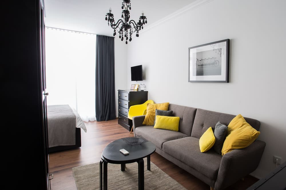 Chambre Confort, vue parc - Coin séjour