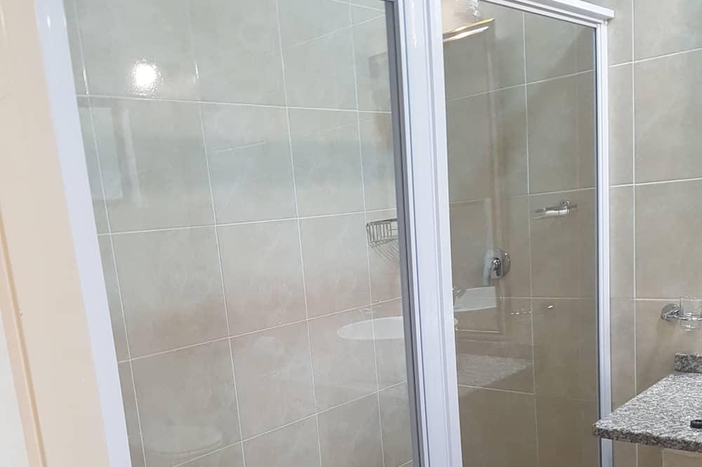 Habitación cuádruple - Regadera en el baño
