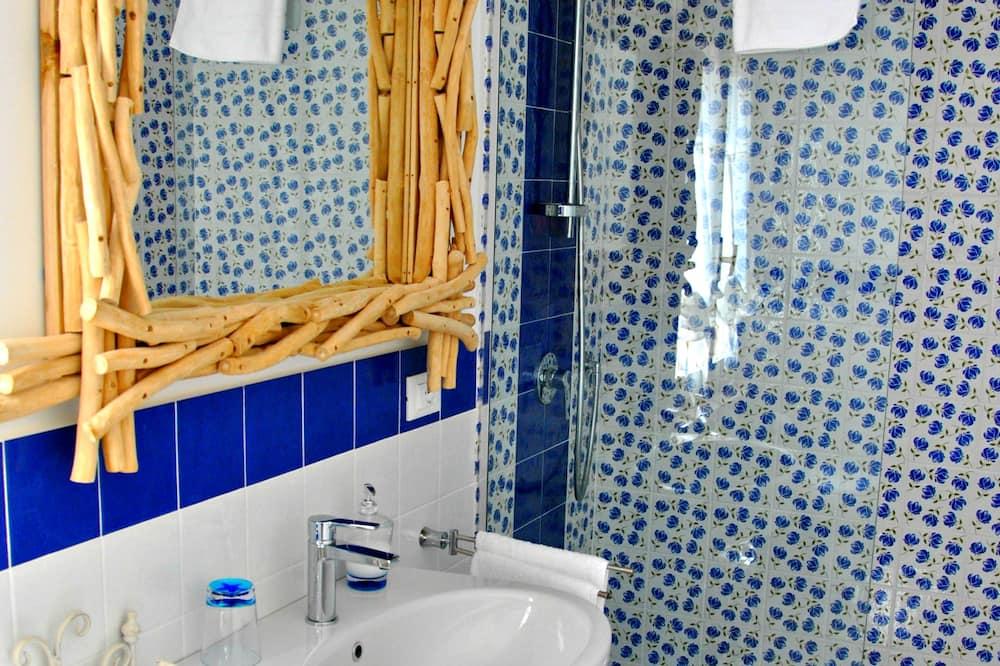 Quadruple Room, Garden View - Bathroom