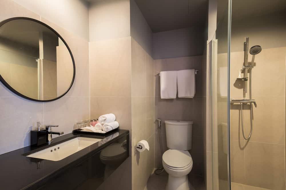Pokoj Deluxe se dvěma jednolůžky - Koupelna