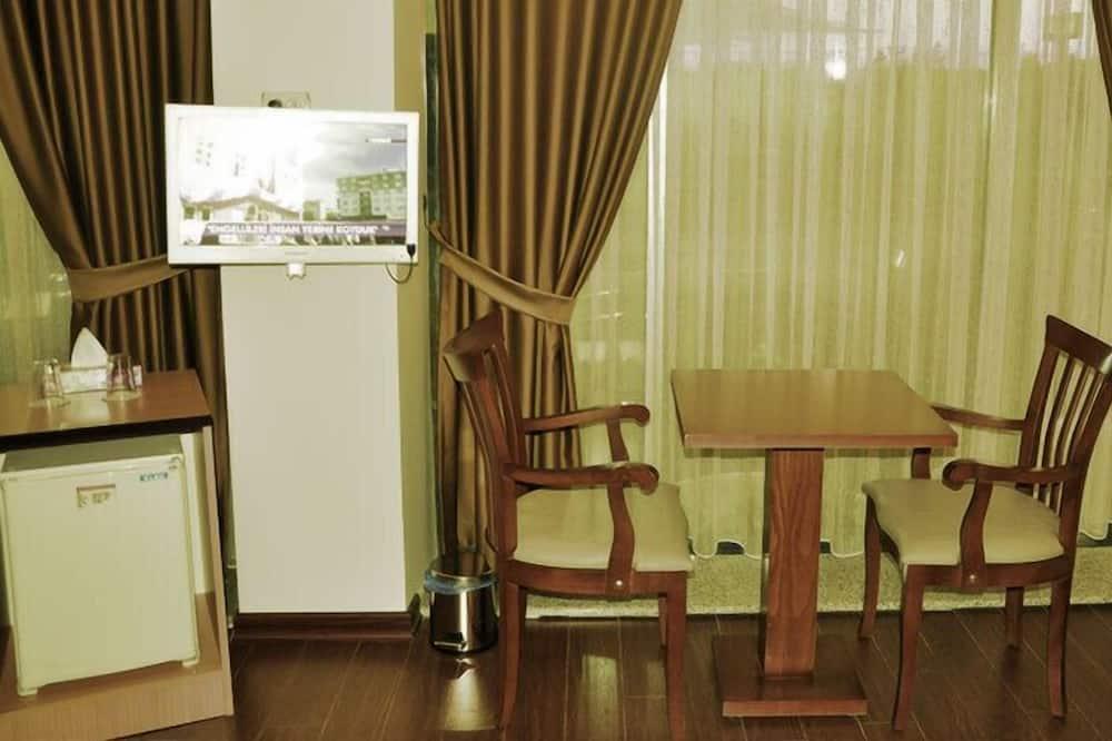 スタンダード ダブルルーム - リビング エリア