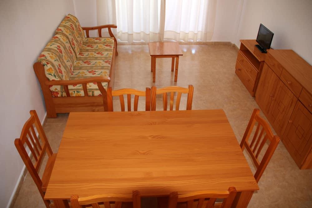 Departamento familiar, 2 habitaciones, terraza, vista al resort - Sala de estar