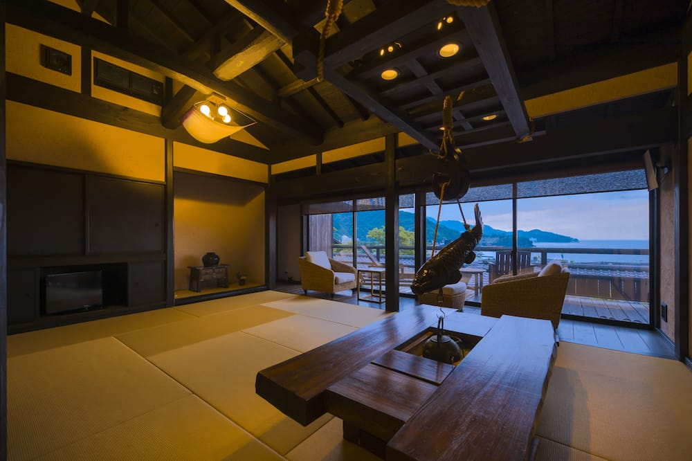 Japanese Western Style Room with Private Open-air Bath, Ocean View - Living Room