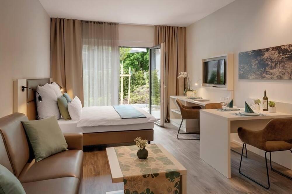 Suite Studio Familiale, plusieurs lits - Chambre