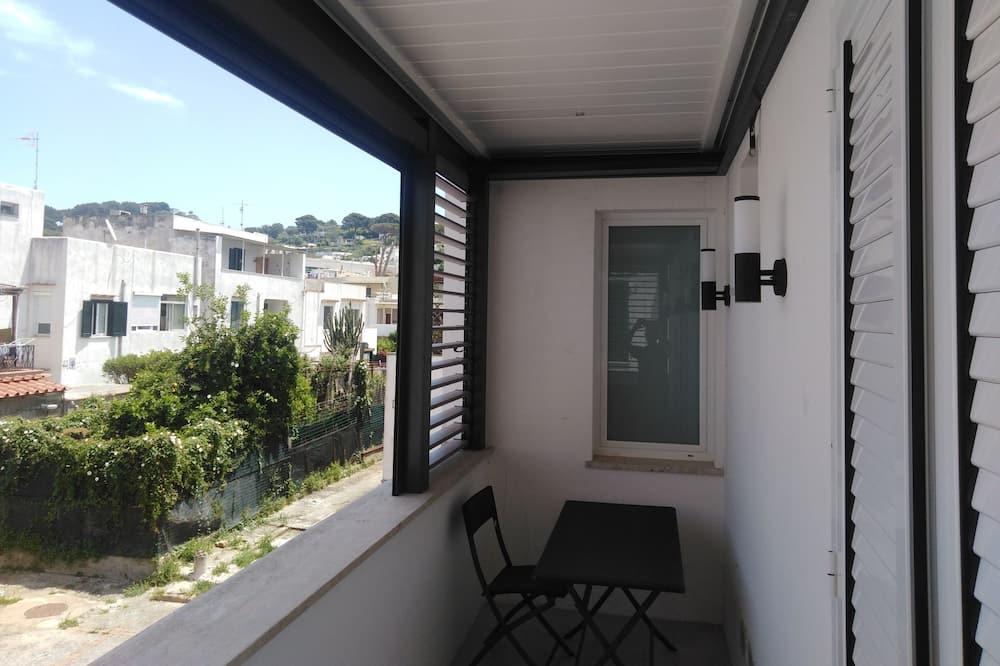 Kamar Double, 1 Tempat Tidur Double dengan tempat tidur Sofa, pemandangan kebun - Balkon