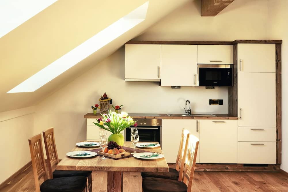 Standaard appartement - Eetruimte in kamer