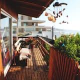 Namas su vitrininiais langais, Kelios lovos, vaizdas į paplūdimį - Balkonas