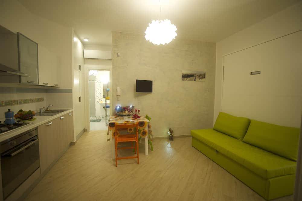 Departamento, 2 habitaciones, cocina, vista al jardín - Sala de estar