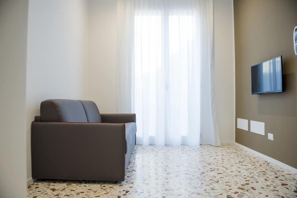 Апартаменты, 1 спальня (Pulzella) - Зона гостиной