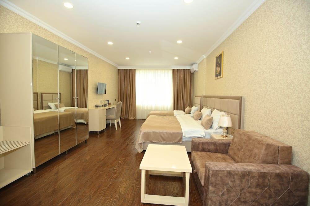 Habitación Confort con 1 cama doble o 2 individuales, Varias camas, vista al patio - Sala de estar