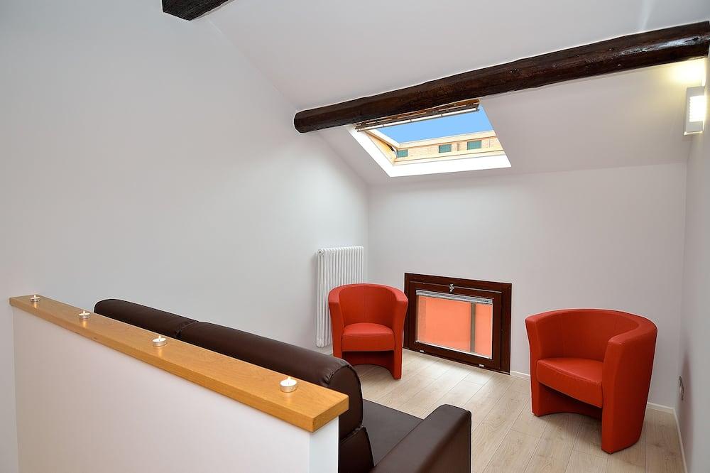 Superior-rum - 1 dubbelsäng - Vardagsrum