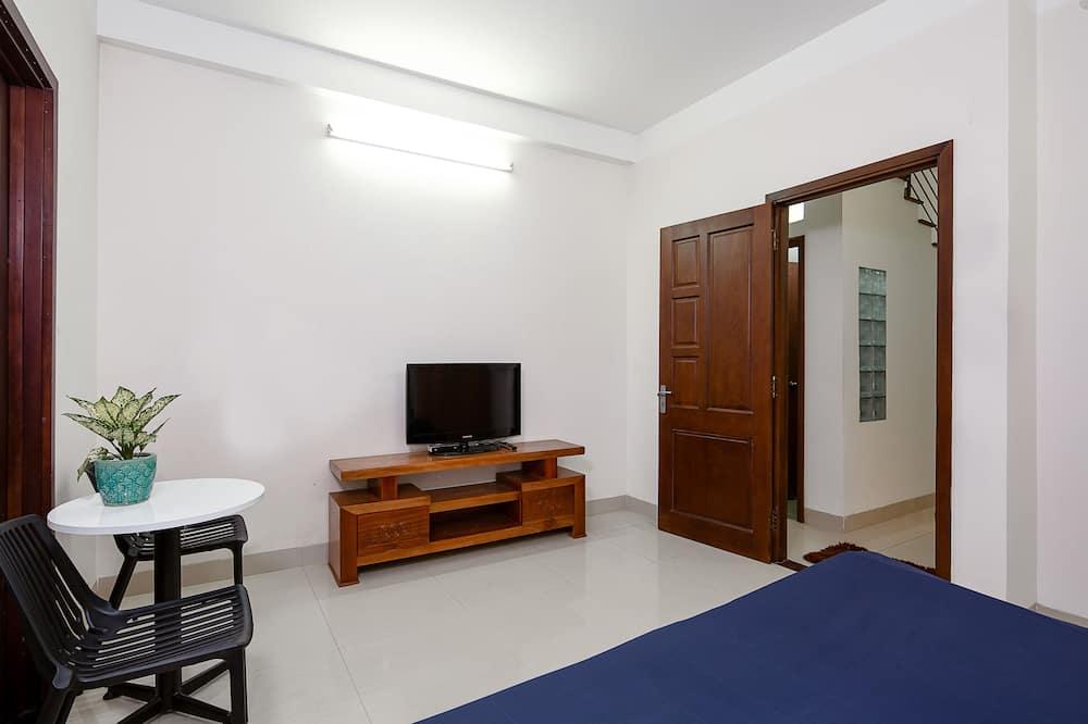 Chambre Deluxe avec lits jumeaux - Coin séjour