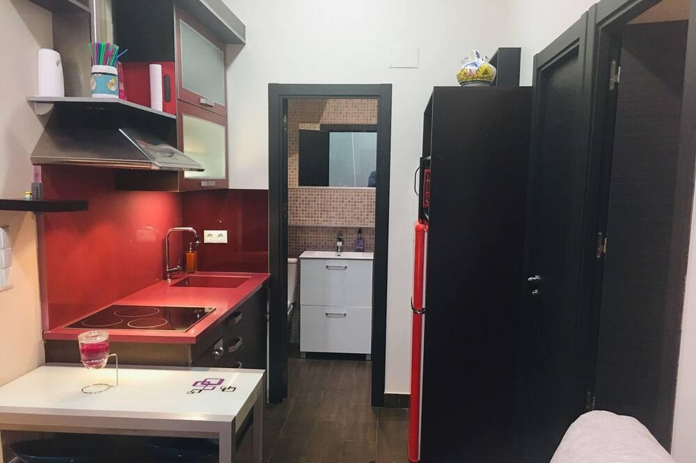 Liukso klasės apartamentai, 2 miegamieji - Svetainės zona