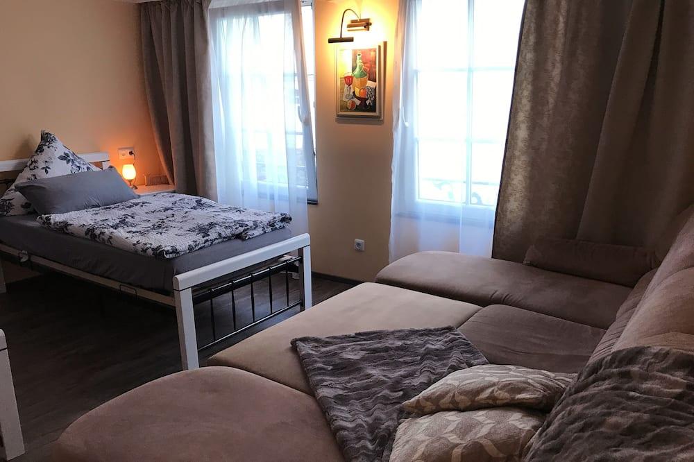 Lägenhet - 1 sovrum (gelb) - Vardagsrum