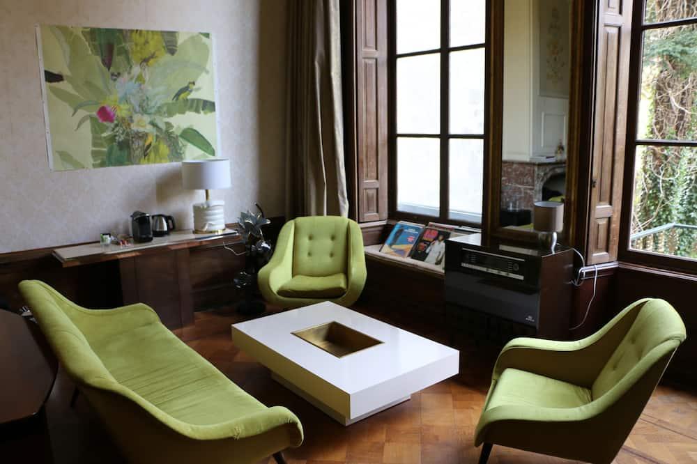 Suite Deluxe, 1 cama Queen size, vista a la ciudad - Sala de estar