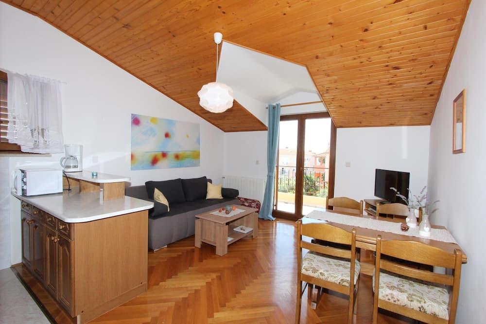 Апартаменты, 2 спальни (Second Floor) - Зона гостиной
