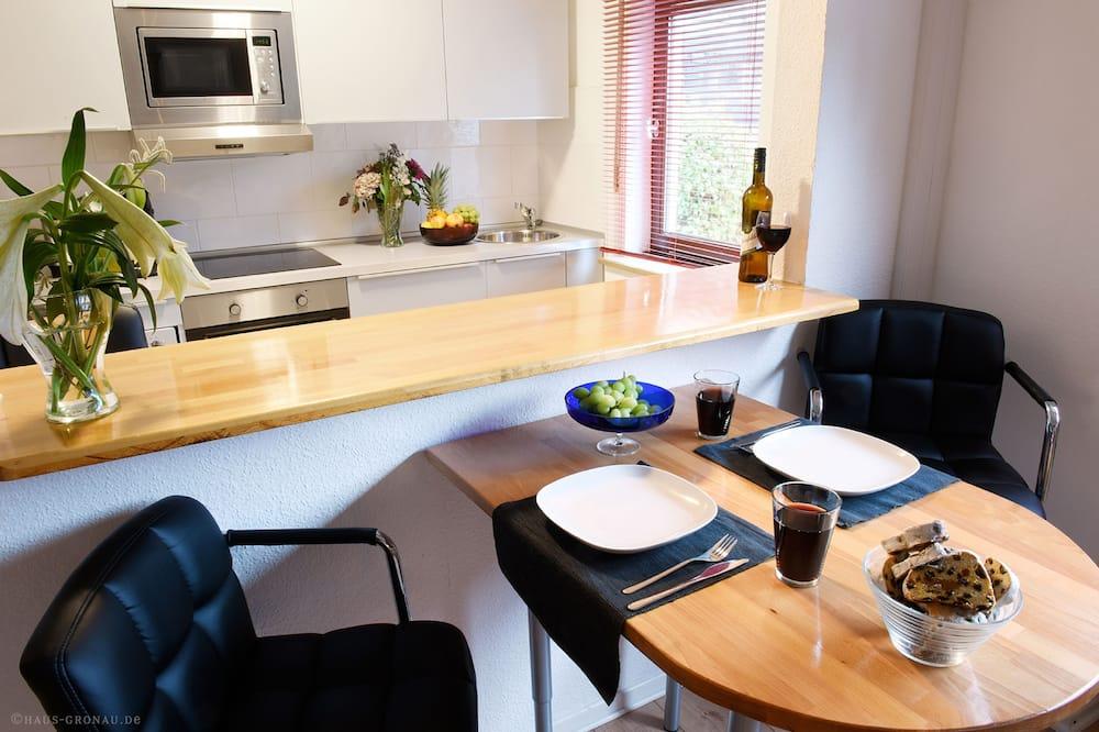 Apartamentai (B) - Vakarienės kambaryje