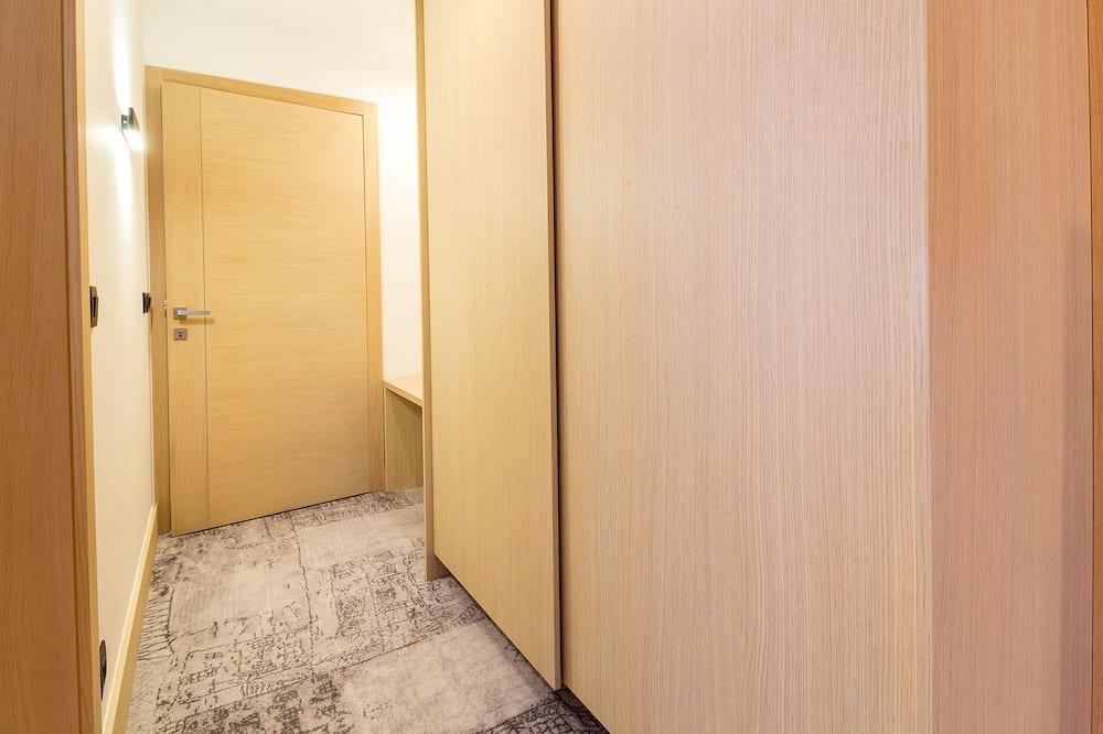 Deluxe szoba kétszemélyes vagy két külön ággyal, kilátással a városra - Nappali rész