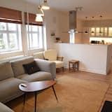 Apartamento Deluxe, Varias camas, vistas al jardín - Zona de estar