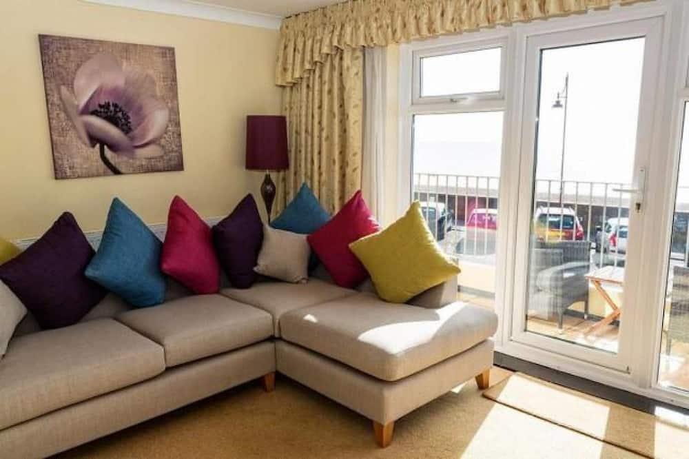 Premier-Apartment, 1Doppelbett und Schlafsofa, Balkon - Wohnbereich