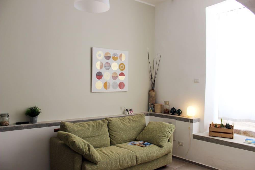 Liukso klasės kambarys, 1 didelė dvigulė lova ir 1 sofa-lova (Due Mari) - Svetainės zona