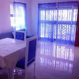Apartamento Comfort em Condomínio Fechado, 1 cama queen-size, Vista Cidade - Área de Estar