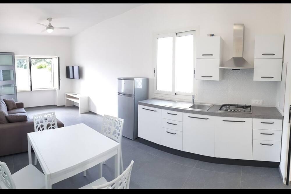 Huoneisto, 1 keskisuuri parisänky ja vuodesohva (Bilocale) - Ruokailu omassa huoneessa