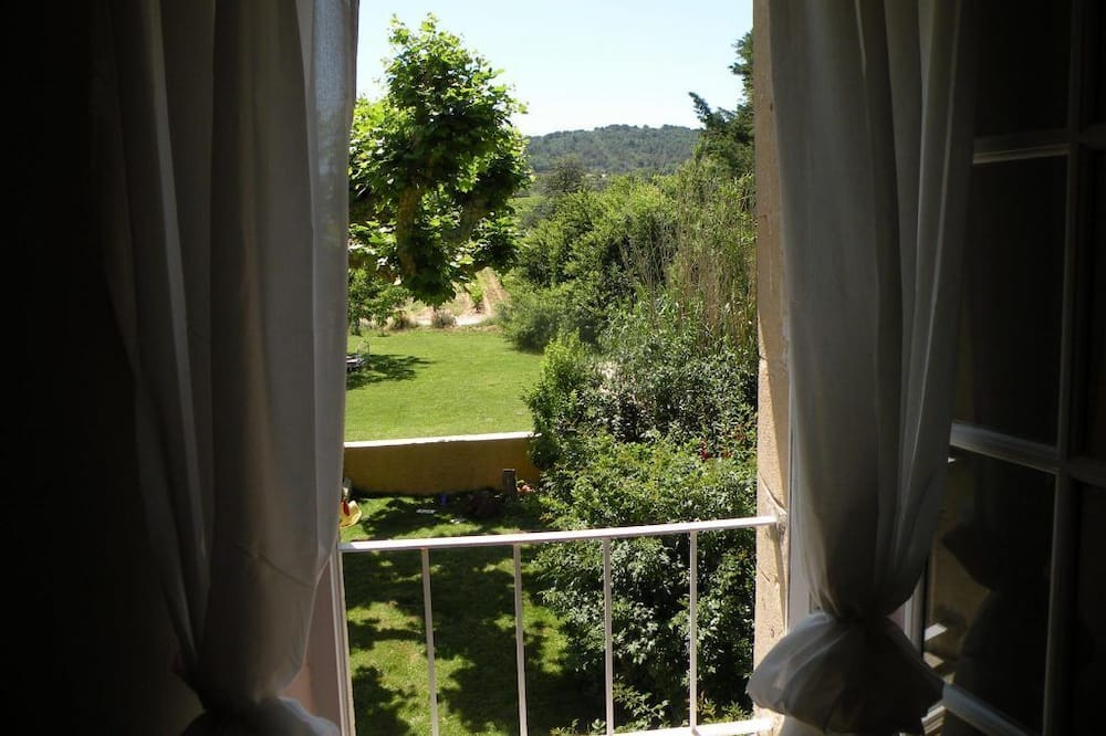 Izba s dvojlôžkom alebo oddelenými lôžkami - Výhľad na záhradu