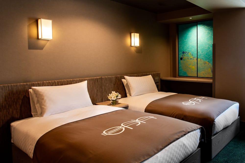 Klasisks divvietīgs numurs, 2 vienguļamās gultas, nesmēķētājiem, privāta vannasistaba - Viesu numurs