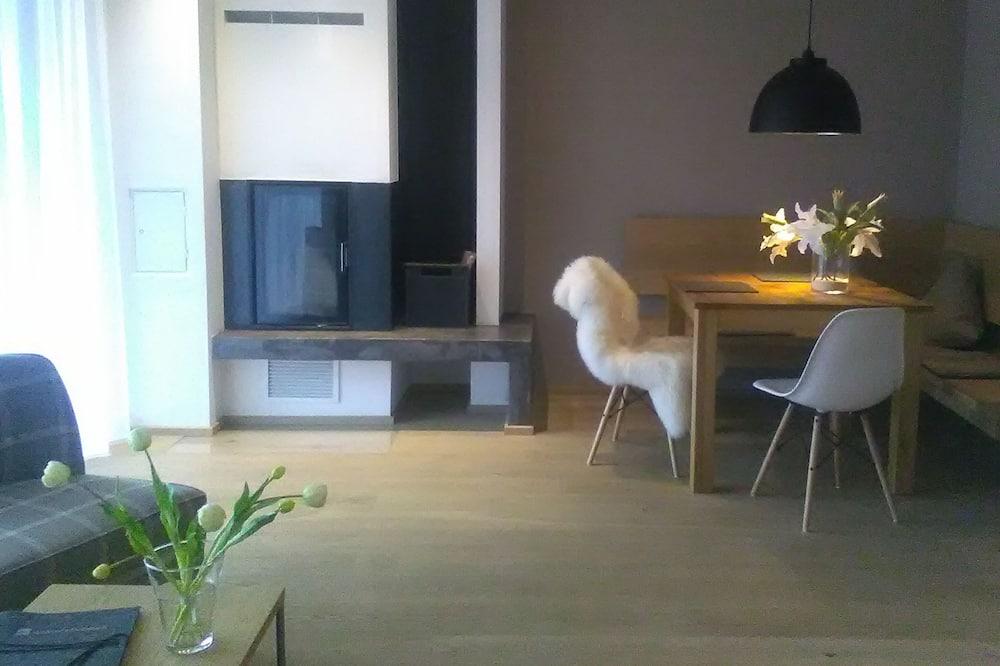 Design appartement, open haard - Woonruimte