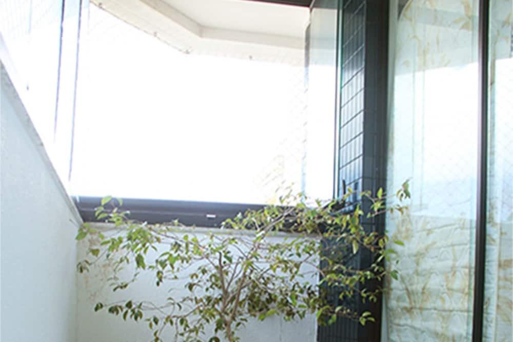 Eenvoudige kamer, Meerdere bedden, Uitzicht op de stad - Balkon