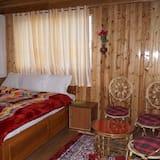 غرفة ديلوكس - سرير ملكي - منظر للجبل - غرفة معيشة