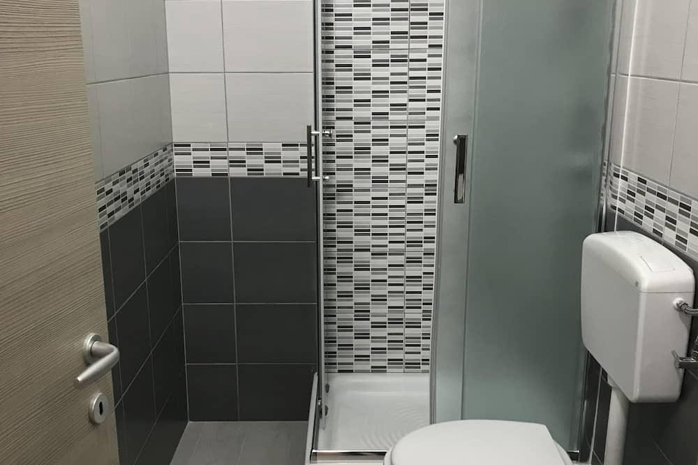 Deluxe Triple Room, City View - Bilik mandi