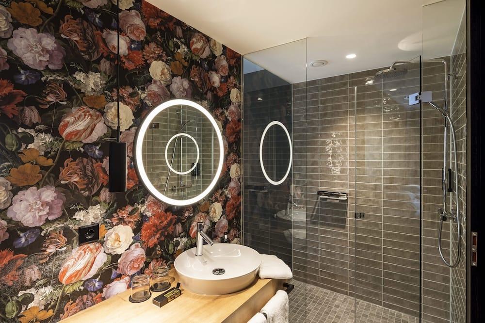 Junior suite, uitzicht op tuin - Badkamer