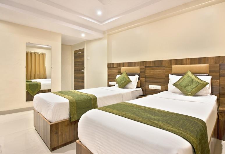 Treebo Trip Rk Hotel, Mumbai, Standard Room, Multiple Beds, Guest Room