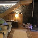 Deluxe-Chalet, 1 Schlafzimmer, Gartenblick (Camelia) - Wohnbereich