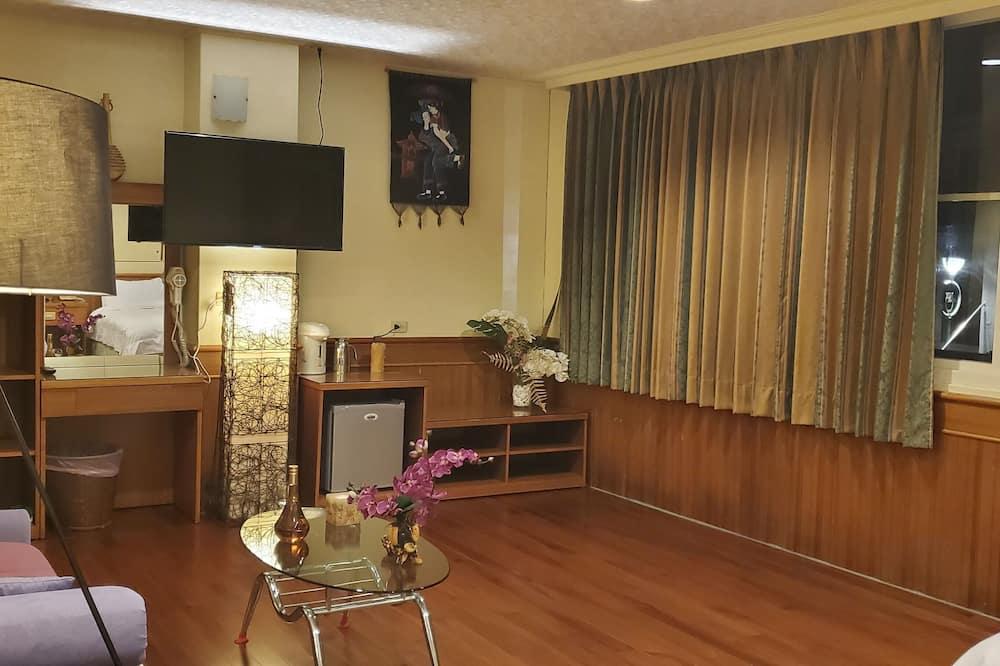 Classic Quadruple Room - Living Area