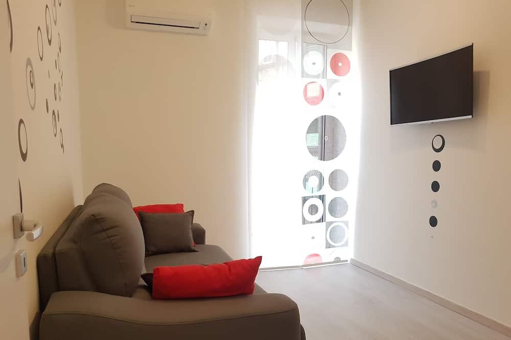 Апартаменты «Комфорт», 1 двуспальная кровать «Квин-сайз» с диваном-кроватью, вид на город - Гостиная