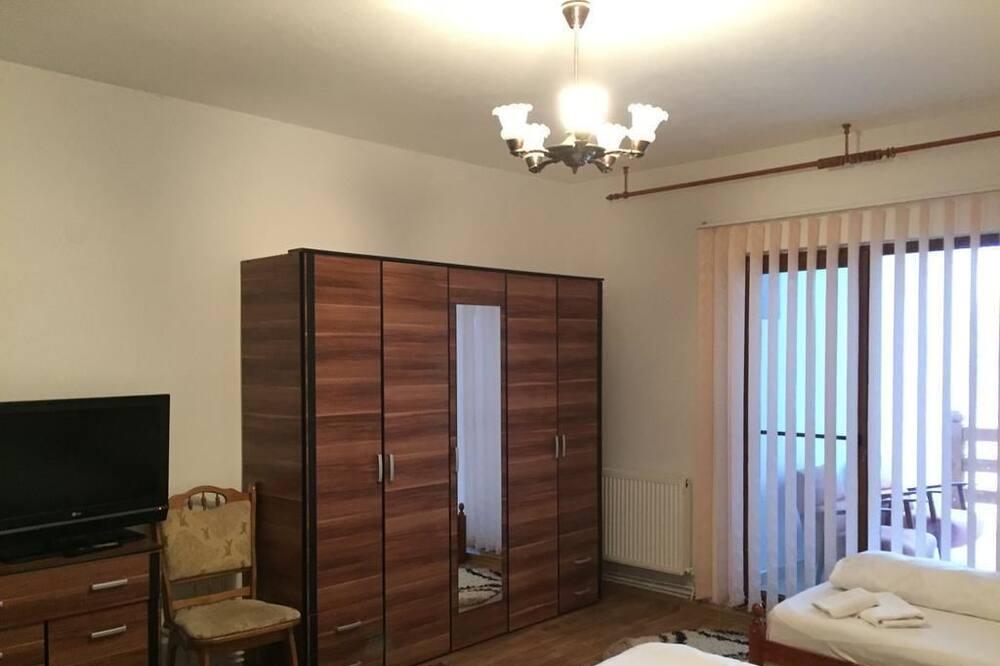 Habitación triple básica - Sala de estar
