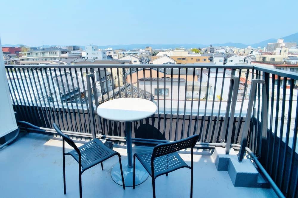 Panorāmas divvietīgs numurs, 1 divguļamā gulta, skats uz pilsētu - Skats no balkona