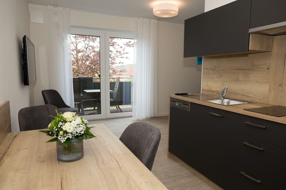 Apartemen Deluks, pemandangan kebun - Area Keluarga