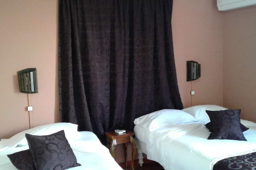 Třílůžkový pokoj typu Comfort, výhled na město - Výhled na město