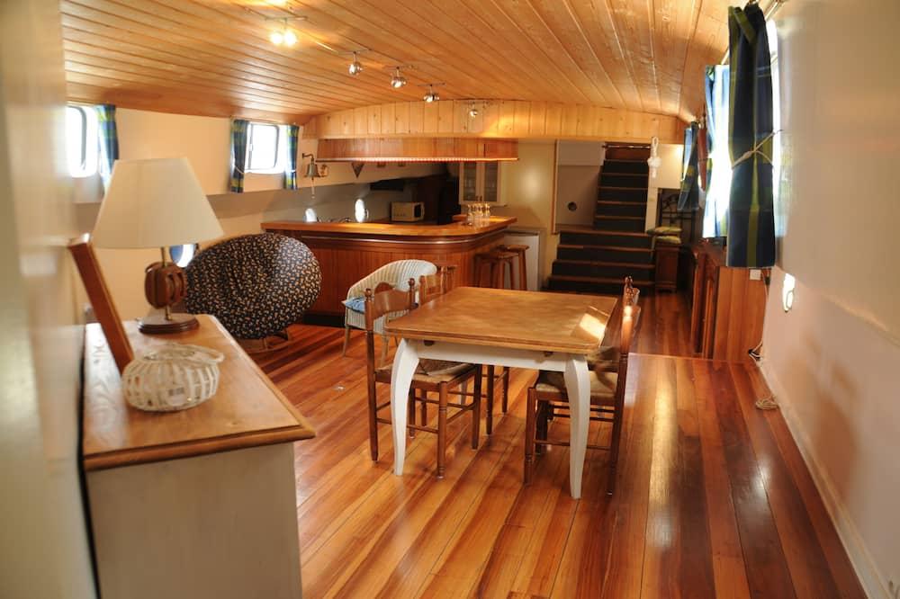 Rekreační domek (Le Saint Loup) - Obývací prostor