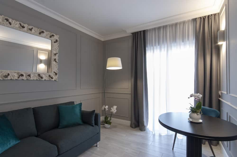 Deluxe appartement, 2 slaapkamers (2 Suite Luxury private bathrooms) - Woonkamer